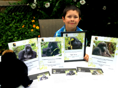 Trajan Lance with his Dian Fossey Gorilla Fund adoption certificates