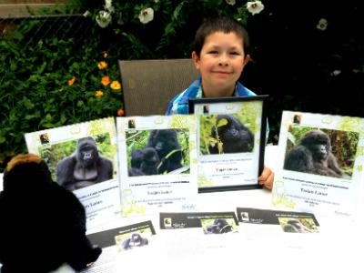 Trajan Lance with his Dian Fossey Gorilla Fund adoption certificates