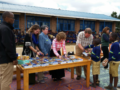 Distributing school supplies at Bisate school