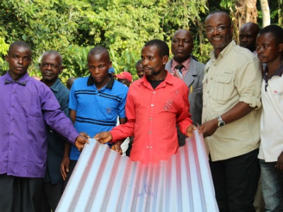Three local landowners were presented with metal roofs