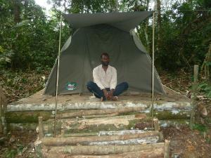 Escobar Binyinyi in a tent with platform