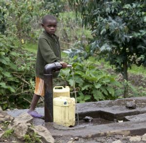 Child fetching water in Bisate Village