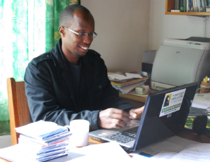 Felix Ndagijimana at the computer