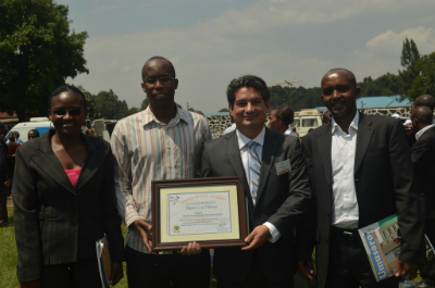 (L to R) Beth Waithera, Felix Ndagijimana, Juan Carlos Bonilla, Chief Warden, Volcanoes National Park Prosper Uwingeli