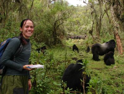 Winnie Eckardt, Ph.D. with gorillas and buffalo herd