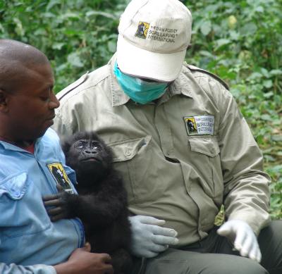 (L to R) Caregiver Gilbert Kavusa, orphan Baraka, Urbain Ngobobo