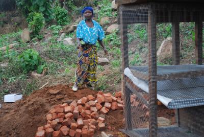 Matembela Mbambu helping to build rabbit cages
