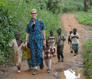 Barb Weber with children at Kasugho