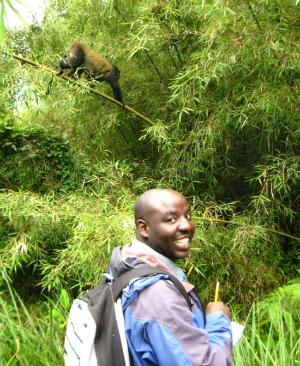 Deogratias Tuyisingize with a golden monkey