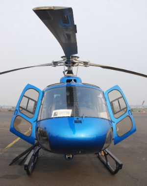 The helicopter with the Fossey Fund logo in its window.