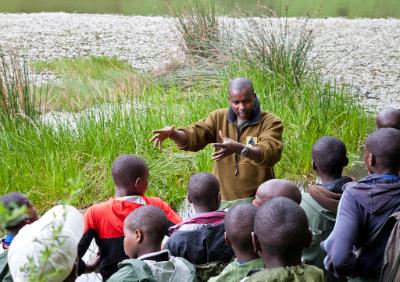 Joseph Karama teaching students in the field.