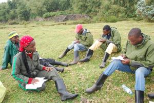 Arakwiye teaching Rwandan university students at Karisoke