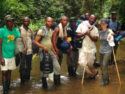 Community trackers, Fossey Fund's Urbain Ngobobo (in white) and Jessica Burbridge at the Punia Gorilla Reserve