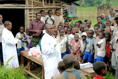 DFGFI health workers educate villagers about parasite prevention measures.
