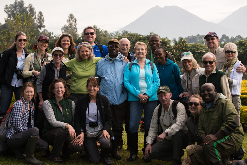 Board, staff and guides set out together to see golden monkeys.